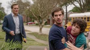"Michael Shannon, Andrew Garfield and Noah Lomax in ""99 Homes"""